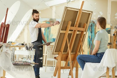 Beraded Artist Painting Portrait in Studio