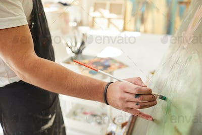 Male Artist Painting Picture Close Up