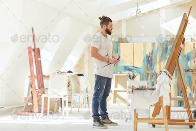 Male Artist in Spacious Art Studio