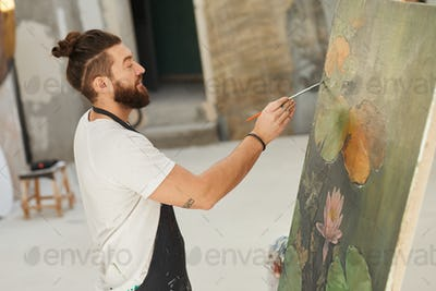 Contemporary Male Artist Painting on Easel