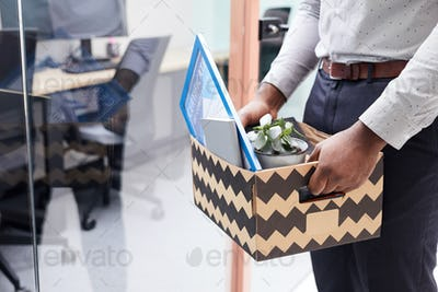 Unrecognizable African Man Quitting Job