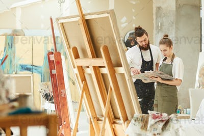Creative Couple in Art Studio