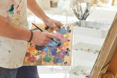 Male Artist Holding Palette Close Up