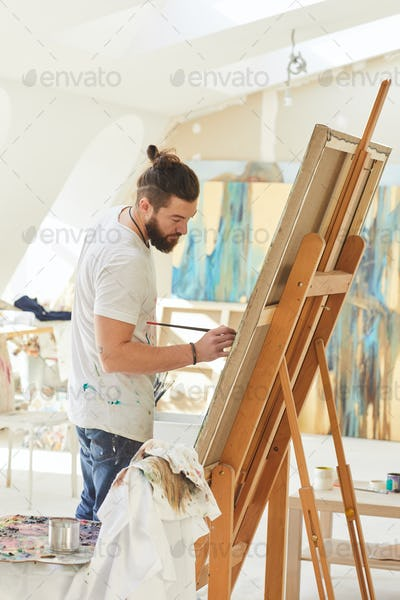 Male Artist Painting in Art Studio