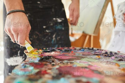 Male Artist Mixing Paint Close up