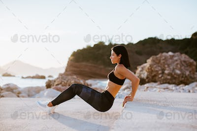 beautiful athletic woman working out outdoors