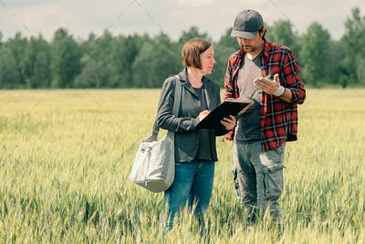 Mortgage loan officer assisting farmer in financial allowance application process