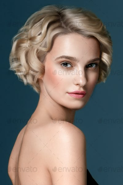 Short curly hair young  woman beauty face portrait