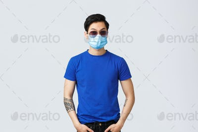 Covid019 lifestyle, people emotions and leisure on quarantine concept. Sassy and cool asian guy in