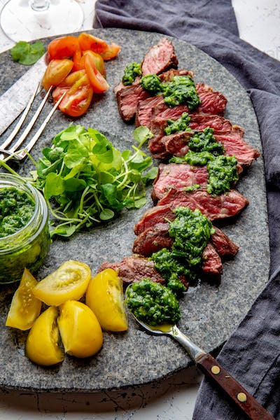 Juicy steak medium rare beef with spices and salad