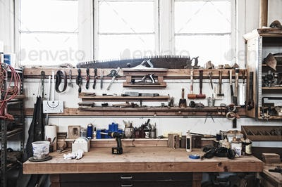 A work station with tools in a woodworking factory.