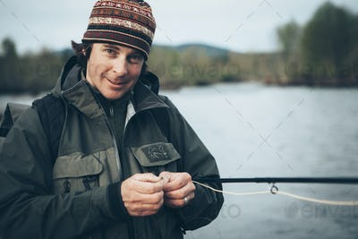 Middle aged man fly fishing on the Hoh River, Olympic National Park, Washington.