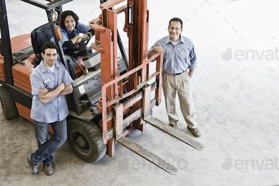 Mixed race team of workers and management person at a landscape company.