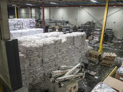 Scrap paper for recycle remaining after cutting and binding.  Scrap from rolls of paper used in