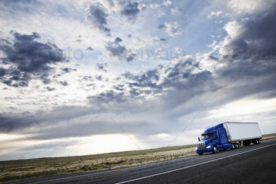 commercial truck driving through the high desert country of eastern Washington, USA