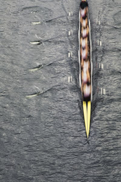 Overhead view of men rowing scull boat during competition on the water off shore in Seattle.