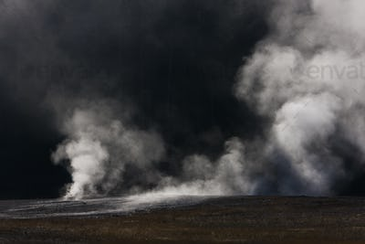 Geothermal activity, and plumes of vapour and steam rising from the ground in Yellowstone National