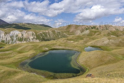 Landscape view with lakes in a valley surrounded by mountains, Tulpar Kul, Kyrgyzstan.