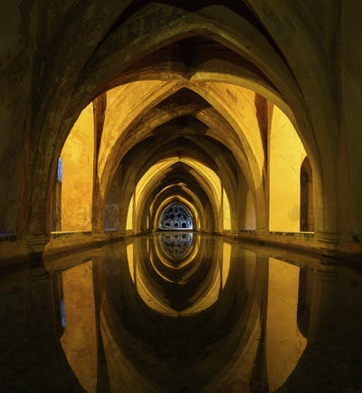 Interior view of of the Rainwater bath in the Alcazar de Seville, Andalusia, Spain.