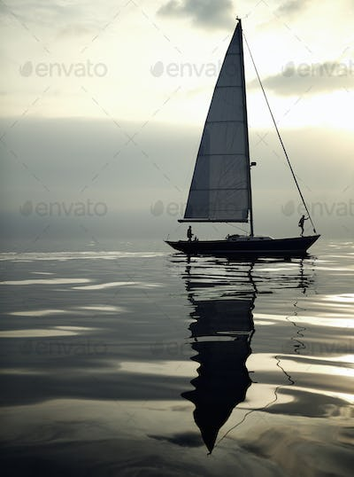 View of sailing boat on the ocean, calm sea.
