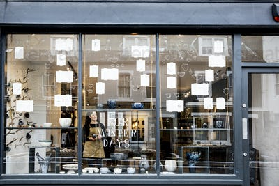 View through window into a pottery shop.
