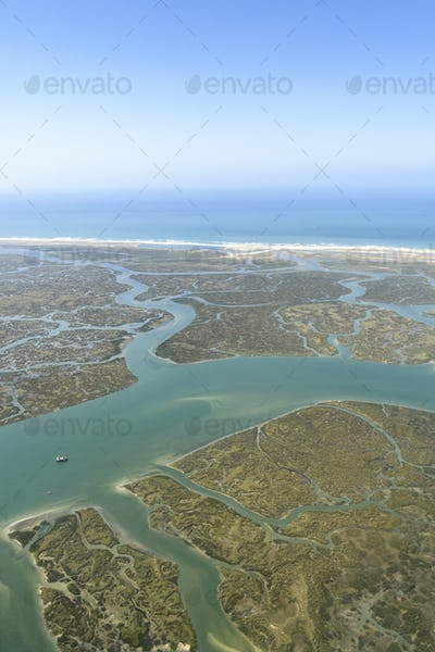 Aerial view of marshland near the coast in Andalusia, Spain.