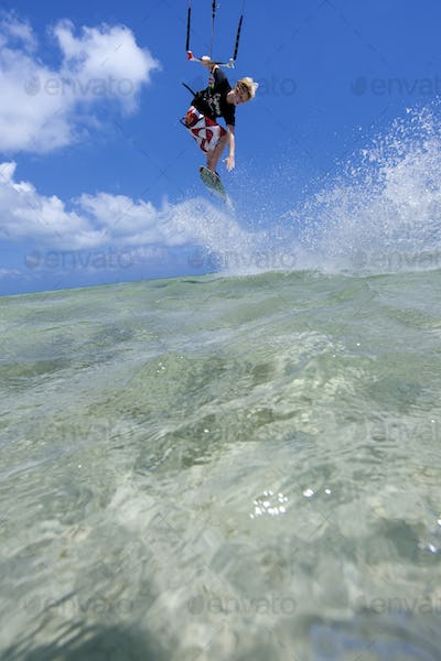 Young man on kiteboard.,Kitesurfing at Anne's Beach.