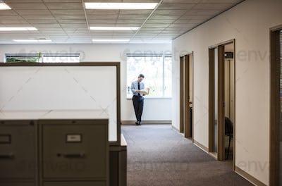 Caucasian man executive in office hallway