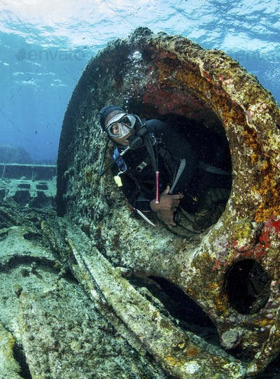 Diver surveys the wreckage of a historic ship off the shores of the Bahamas.