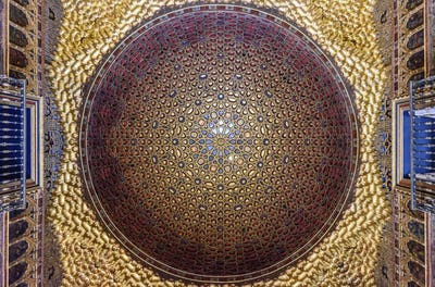 Interior low angle view of golden dome in the Hall of Ambassadors, Alcazar de Seville, Andalusia,