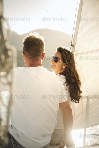 Man and woman on a sail boat.
