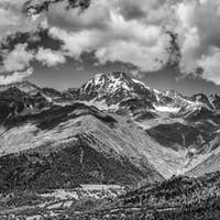 Landscape with snow-capped mountains under a cloudy sky, Svaneti, Georgia.