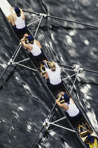 Overhead view of a female rowing crew in their racing shell, rowing boat.