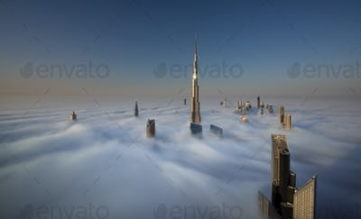 View of the Burj Khalifa and other skyscrapers above the clouds in Dubai, United Arab Emirates.