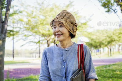 Portrait of a smiling senior woman wearing a crochet hat.