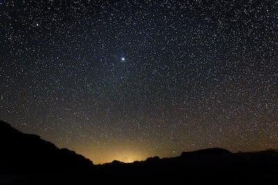 Stars across the sky in the Wadi Rum desert wilderness in southern Jordan at night.