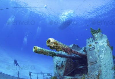 Extremely clear water and good visibility and objects on the seabed, a sunken warship creating an