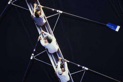 Overhead view of men rowing scull boat during competition in Seattle.