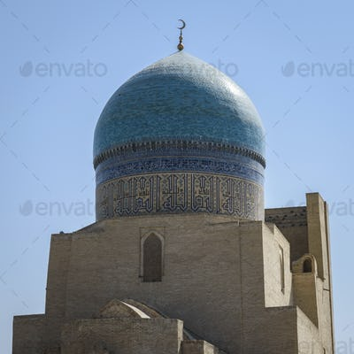 Exterior view of 16th century Po-i-Kalyan mosque with a blue tiled dome in Bukhara, a UNESCO world