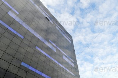 Low angle exterior view of modern black and blue glass facade of the new Black Diamond building of