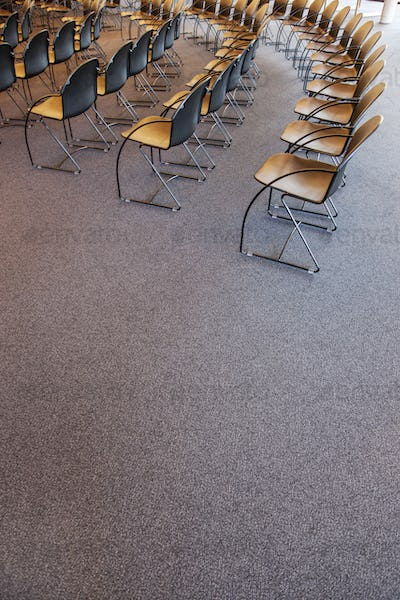 Folding chairs lined up for a business meeting