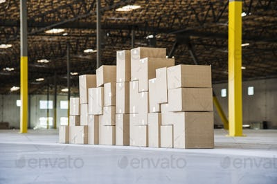 Group of cardboard boxes in a brand new large warehouse space.