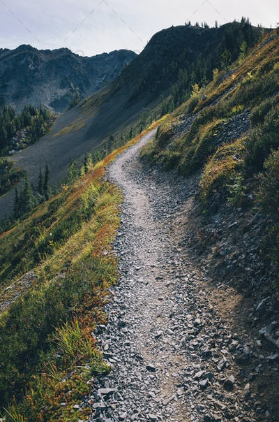 Hiking trail in the North Cascades, Pacific Crest Trail through pristine alpine wilderness, autumn,