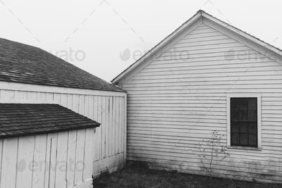 Outbuildings and barn on farm with dense fog, Historic Pierce Point Ranch, Point Reyes National