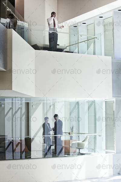 Business people on two floors of a large business center.