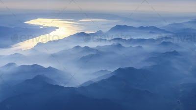 Aerial view across misty mountain range in the Veneto region, Italy.