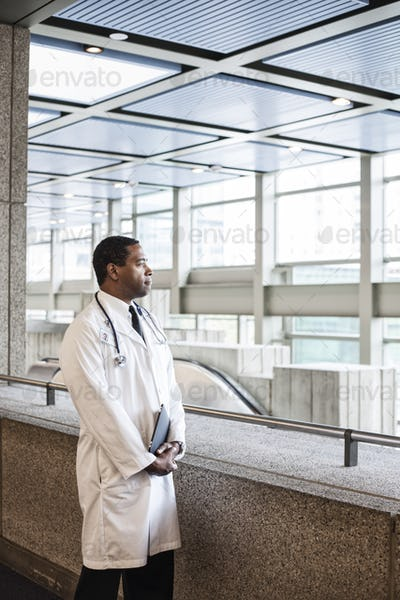 Black man doctor in lab coat with a stethescope.