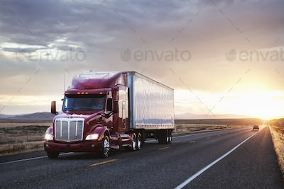 3/4 front view of a commercial truck on the road at sunset  in eastern Washington, USA