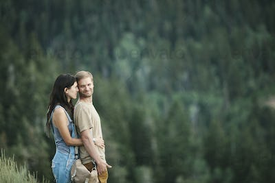 A couple outdoors in the mountains.