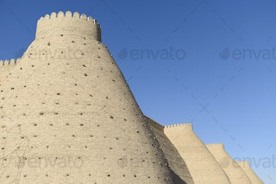 Wall of the Bukhara Fortress, the Ark in Bukhara with tapering high walls.
